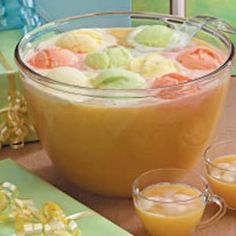 Party Punch--pineapple juice, orange juice, frozen limeade and lemonade concentrate, ginger ale and orange, lemon and lime sherbet. Complete recipe under this pin!