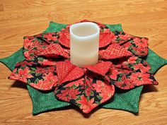 Poinsettia Christmas Table Centerpiece, Fold N Stitch Candle Fabric Wreath, Table Runner, Red Green Candleholder, Holiday Decor, Handmade by MulberryPatchQuilts on Etsy https://www.etsy.com/listing/483613053/poinsettia-christmas-table-centerpiece