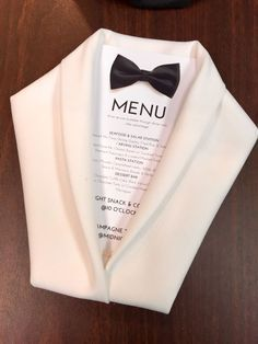 This tuxedo jacket napkin fold would be ideal for a black-tie wedding, a Gatsby-themed wedding, or a gay wedding with two grooms. Make sure to put a bowtie (printed or fabric) at the top of the enclosed menu to complete the effect!