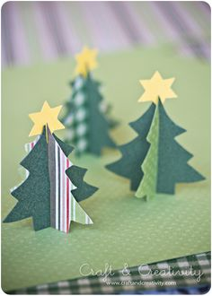 paper christmas trees! ('cause, you know, with as cold as the weather has been lately we might have two christmases this year...)