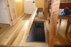 Trapdoor to Basement, Build a trapdoor into your basement. If space is limited for a full stairwell, a well built trapdoor will give you ac...