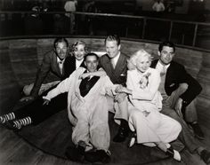Randolph Scott (1898-1987), Carole Lombard (1908-1942), A. C. Blumenthal (1885-1957), not known, Toby Wing (1915-2001) and Cary Grant (1904-1986) at a party hosted by Lombard at Venice Pier, June 1935 (and if anyone can identify the gentleman in the middle, that would be great!)