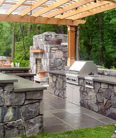 love the pergola and concrete/stone counter tops and fire place