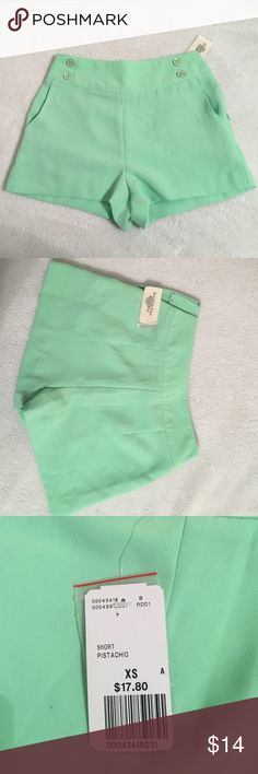 """NWT Mint Green High Wasted Shorts NWT F21 high waisted shorts with button detail! Slide clasp and zipper. Also has pockets More of a mint green rather than """"Pistachio"""" as listed on tag. Forever 21 Shorts"""