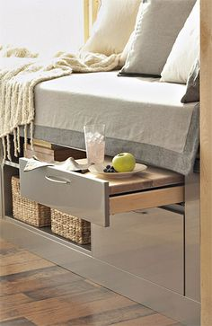 Combine Bedding with Storage  cabinets stashed under a daybed provide storage and an unexpected amenity--a pull-out tray for breakfast in bed.