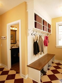 A mudroom locker with a bench will help corral your family's belongings.