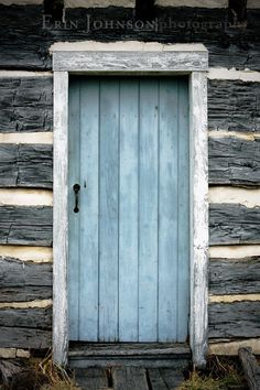 blue-washed door on an old log cabin.