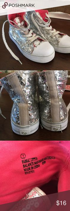 Sparkly Size 7 Comverse Justice brand, high top converse style shoes, hot pink on the inside. Worn in a bit but still in pretty good shape. Very cute. Justice Shoes Sneakers