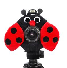 Camera Creatures ™ Look At Me Ladybug This must-have lens accessory comes complete with a squeaker.