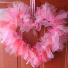 Make a Valentine heart wreath #ValentinesDIY  I would even hang one of these in a little girl's room!