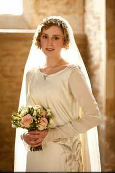 Lady Edith Crawley on her wedding day.   Hiss and boo to Sir Anthony!