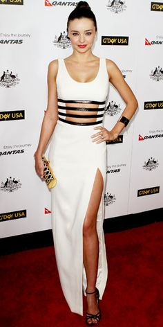 Gorgeous Victoria Secret Supermodel Miranda Kerr in an edgy bondage inspired black and white Michael Kors evening gown