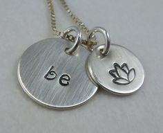 Hand Stamped Silver Yoga Necklace, Be Calm, Lotus Flower charm - Personalized Initial Necklace - mothers day jewelry. $32.50, via Etsy.