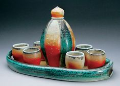 Photo of Charity Davis-Woodard's thrown and altered porcelain liquor set.
