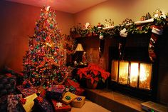 Christmas tree, presents, stockings, fire place