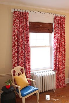 I love this fabric and the creative way he hung these curtain panels!