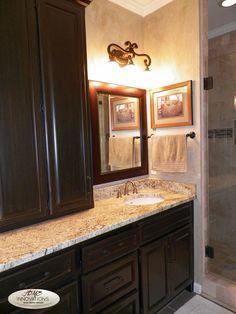 Black cabinets, granite countertops, vanity top storage