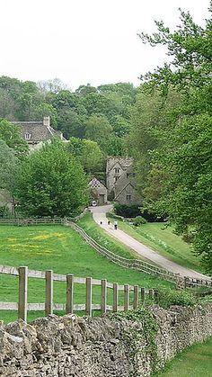 Bibury ,UK.  What a charming little village! I want to follow that little road as it meanders into it!