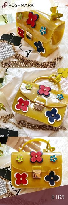 """auth NWT FURLA Jelly """" BON BON"""" limited bag This is an beautiful, new with tag, super fun to play with Jelly bag made by FURLA. Limited edition Come with tag, dust bag and extra gold shoulder chain.Worry about raining days? Or want to go to beach for a party and don't want to get your designer leather bag dirty? This is it! retail $ 375 plus tax. Brand new. Can be worn as shoulder bag, wallet on chain, crossbody or just the bag itself. This beauty made with jelly, leather floral decor &gold…"""