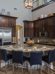 Drew and Jonathan Scott's kitchen includes plenty of cabinet storage and a large granite island for entertaining.