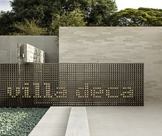 villa deca, são paulo ⊚ pinned by www. Entrance Signage, Outdoor Signage, Exterior Signage, Retail Signage, Wayfinding Signage, Signage Design, Gate Design, Facade Design, Environmental Graphic Design