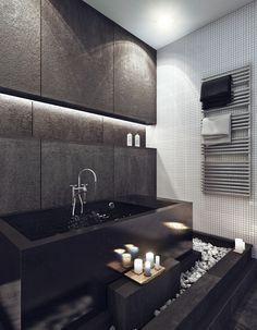 minimalistische schwarze Badewanne Kiesel