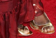 Laverne Cox wearing metallic Lonia sandals