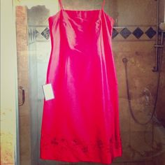 Ann Taylor RED Holiday 100% Silk dress NWT Perfect Holiday dress. Pictures don't do this dress justice. Red 100% Silk dress with beaded design around bottom of dress front and back. Love this dress but too big on me and needs to be worn! Ann Taylor Dresses
