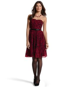 Red and black strapless belted animal print dress...a necessity for the punch factor! Add a black jacket for work or some bling jewelry for an evening outing - White House | Black Market