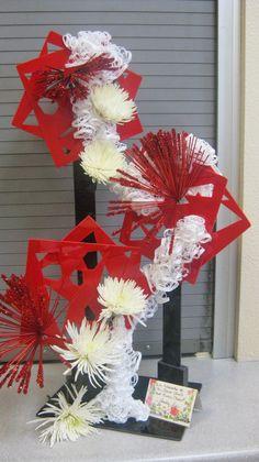 Creative or Angular design by Jackie Nunes. New Garden Club Journal. Flower arrangement. Floral design
