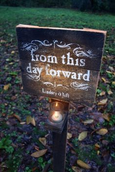 Signage for an outdoor wedding reception. Super cute idea, especially along a candle lit path to a tent.