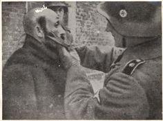 An SS man cutting the sidelocks of a Jew.