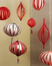 This year, let paper be the star of the Christmas tree: Fold it, slice it, twist it, and curl it into colorful lantern-inspired ornaments.