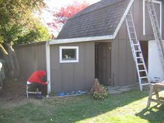 Painting the trim on the toolshed