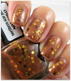 This polish is so cute! It makes me think of pennies and other coins. It looks very sheer and sparkly~