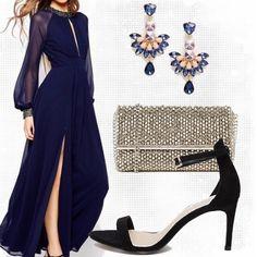 Bellissimo abito blu. Leggero e sensuale come una farfalla. Indicato per una serata importante o per una cerimonia. D'obbligo la pochette scintillante.