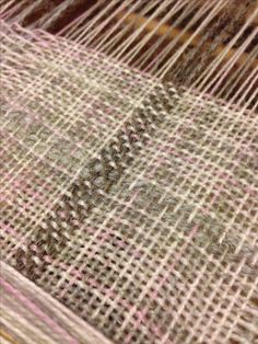 Wool warp and weft handwoven on rigid heddle loom.