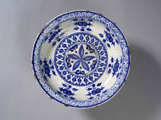Dish with blue and white design Ceramic (stonepaste, thrown), with cobalt-blue paint under colourless alkali glaze Centimetres: 6 (height), 32.7 (outside diameter) early 16th century Safavid dynasty Area of Origin: Tabriz, Iran Area of Use: Tabriz; Iran Wirth Gallery of the Middle East 909.29.1 ROM