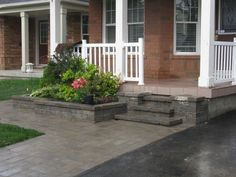 landscaping Toronto - front entrance stairs and planter with walkway.