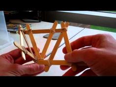 How to make a rubber-band catapult  Supplies        10 craft sticks      15 rubber bands      1 plastic spoon