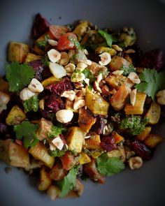 Sweet potato and beetroot roasted salad with coriander and mustard dressing. vegan