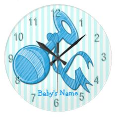 The adorable Boy Baby Rattle Round Wall Clock features a light blue and white striped background that is customizable, light blue baby rattl...