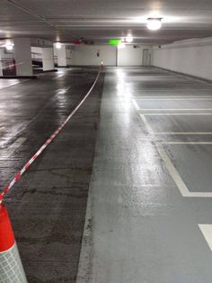 Pressure cleaning results in an underground car park.