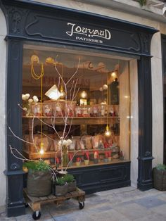 Jouvaud Pâtisserie | Carpentras, France. Crates on wheels great way to showcase outside store