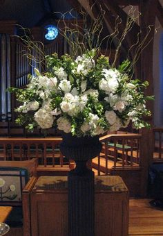 Dream wedding flowers for church - gorgeous and big...maybe not in the urn/pedestal