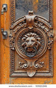 Antique lion wood and iron door knocker, Helsinki, Finland                                                                                                                                                     More