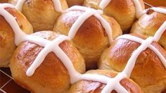 An Easter tradition, these lightly sweetened cinnamon yeast buns feature tender little currants strewn throughout.  An egg yolk wash gives these buns a browned, glossy finish, making a canvas for the namesake cross, a painting of milk and sugar icing.