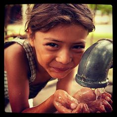 Clean drinking water from a charity: water project in Honduras helped a community from disease and brings joy to many children much like the little girl in this photo. *For every repin, Manduka will volunteer 10 minutes for Heal the Bay.