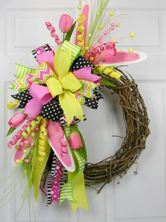 A versatile ready to use Terri Bow with Easter Accents. The Terri Bow has six different ribbons and is mixed with Easter bunny ear picks and tulips. This is a reusable wreath accent you can place on a Spring Projects, Easter Projects, Easter Crafts, Easter Decor, Easter Ideas, Easter Wreaths, Holiday Wreaths, Holiday Crafts, Mesh Wreaths