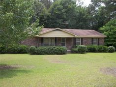 3.4 Acres with Full Brick, 3 Bedroom, Ranch Home. 2-Car Attached Garage with added 2-Car Carport; plus detached 2-Car Garage and storage room. At this price, you can come in clean up & paint and make it your own! $l09,900.